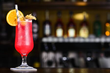 Photo pour Strawberry Colada. Red decorated cocktail on the bar table. - image libre de droit