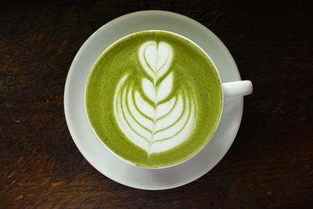 Foto de A cup of green tea matcha latte on wooden background - Imagen libre de derechos