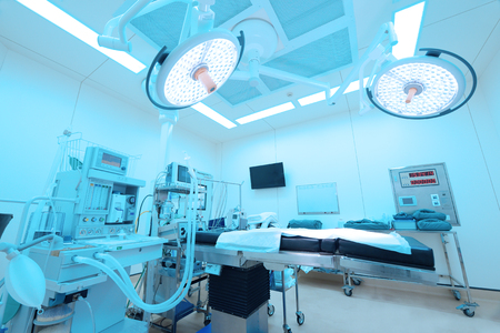 Photo for Equipment and medical devices in modern operating room take with art lighting and blue filter - Royalty Free Image