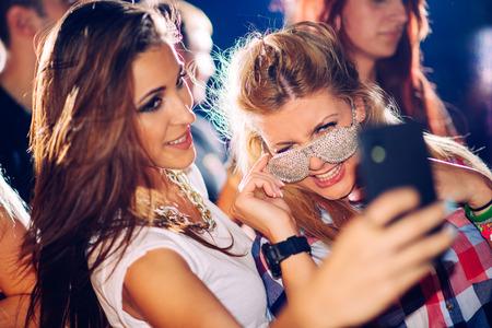 Photo pour Party people taking selfie - image libre de droit