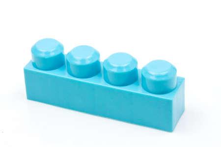 Photo pour Blue plastic building block isolated on white background. Developmental toys for children. - image libre de droit