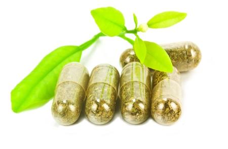 Photo pour herbal medicine pills with green plant on white background  - image libre de droit