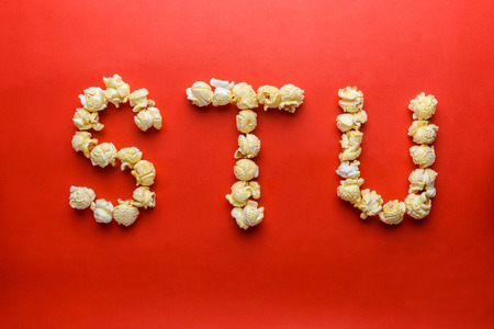 popcorn forming letter S,T,U on red background