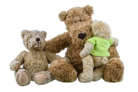 Photo pour Two bear baby doll sitting on mother bear doll and hugging each other showing love and concern in the family isolated on white background - image libre de droit