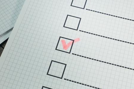 Photo pour The red pen check point in black box on paper. - image libre de droit