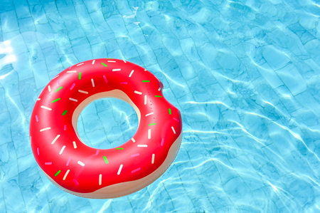 Photo pour Donut shape, floating rubber ring in the swimming pool - image libre de droit