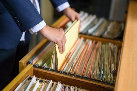 Foto de Employees are managing documents at the office. - Imagen libre de derechos