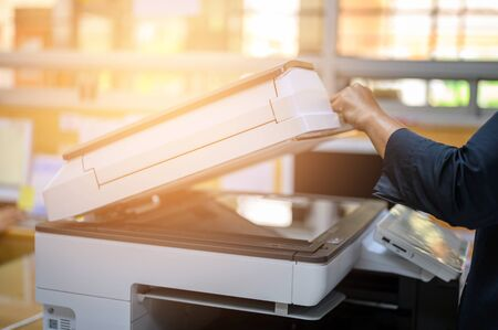 Photo for Office staff photocopying at the document maker - Royalty Free Image