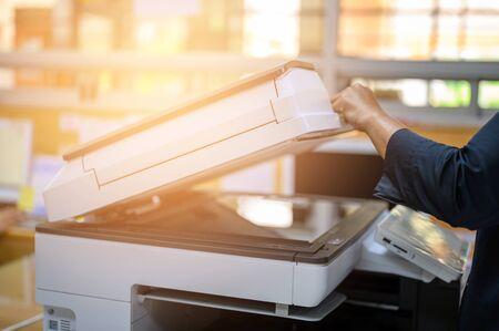 Photo pour Office staff photocopying at the document maker - image libre de droit