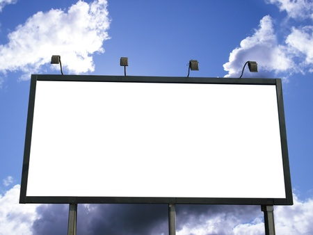 Blank outdoor billboard for advertising on blue sky with clouds. White empty space for your text or copy.