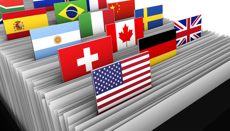 Photo pour International business and global market concept with a close-up of a customer file directory with document and some international flags on tags. - image libre de droit