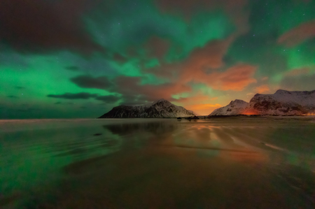 Photo for Beautiful view of scenic Lofoten Islands archipelago winter scenery, with Northern Lights or Aurora Borealis, Beautiful mountain landscape in winter Norway, Scandinavia. - Royalty Free Image