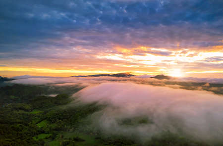 Photo pour Beautiful Aerial view sunrise over the mountain range at the north of thailand, Beauty rainforest landscape with fog in morning - image libre de droit