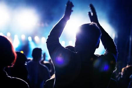 Photo pour Crowds of people having fun on a music concert - image libre de droit