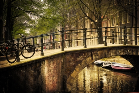 Amsterdam, Holland, Netherlands. Romantic bridge over canal. Old town