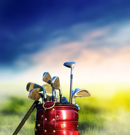 Foto de Golf clubs on grassy golf course. Sport, recreation - Imagen libre de derechos