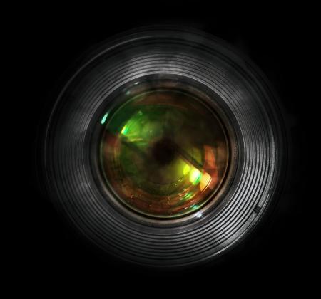 DSLR camera lens, front view, black background.