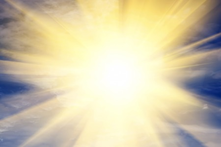 Explosion of light towards heaven, sun. Concepts of religion, God, providence.