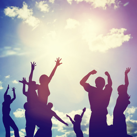 Photo pour Happy friends, family jumping together in a circle having fun and expressing emotions of joy, freedom, success. Silhouettes on sunny sky - image libre de droit