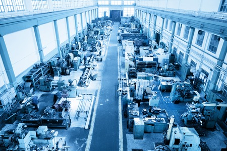 Heavy industry workshop, factory. CNC, boring, threading, drilling machines. Aerial, top view. Blue tone