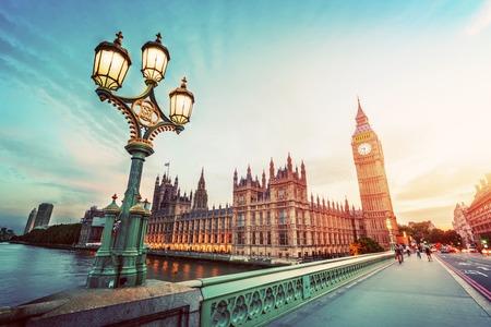 Big Ben seen from Westminster Bridge, London, the UK. at sunset. Retro street lamp light. Vintage
