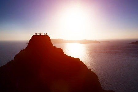 Photo for Happy group of people, friends, family on the top of the mountain over ocean celebrating life, success. Children, parents, seniors. Conceptual - Royalty Free Image