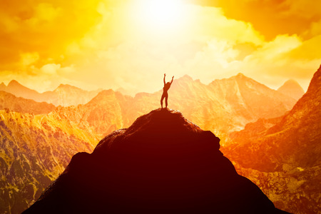 Photo for Happy woman with hands up on the peak of the mountain enjoying the success, freedom and bright future. - Royalty Free Image