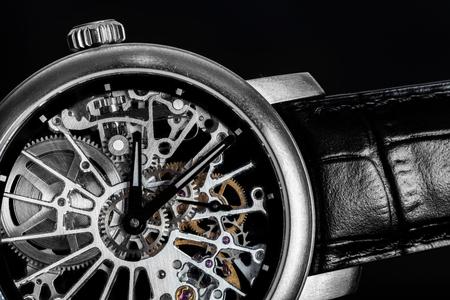 Photo pour Elegant watch with visible mechanism, clockwork close-up. Luxury, men's vintage accessory. Time, fashion concept. - image libre de droit