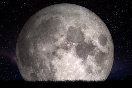 Full moon at night. Grass in the foreground. Perfect for background, copy-space. Elements of this image furnished
