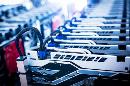 Photo pour Bitcoin miner. Cryptocurrency business. IT equipment. Electronic devices standing in a row. - image libre de droit