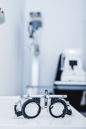 Eye testing glasses in optician\'s office. Optometry, medical instruments.
