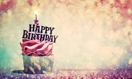 Photo for Happy birthday cupcake on glitter colorful background. Candle light - Royalty Free Image