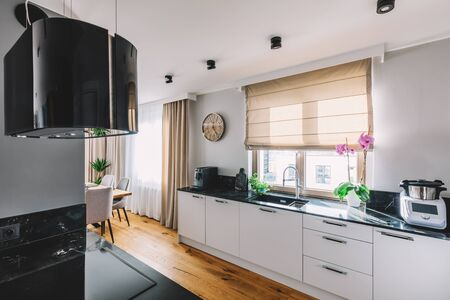 Photo pour Modern kitchen interior design. Wooden floor and quartzite tabletop - image libre de droit