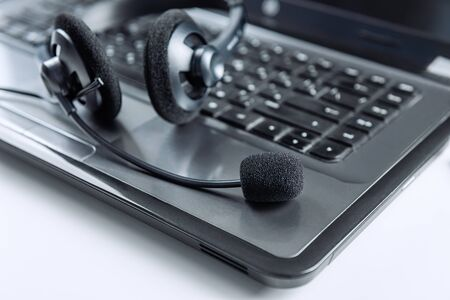 Photo for Headphones with microphone on laptop keyboard. Communication concept. - Royalty Free Image