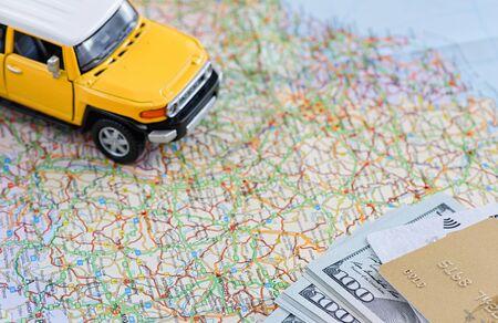 Foto de Model SUV on the map. There is money and a credit card. Travel concept.  - Imagen libre de derechos