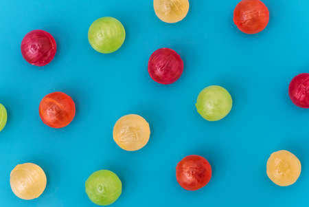 Still life of colorful spherical candies. Flat lay.