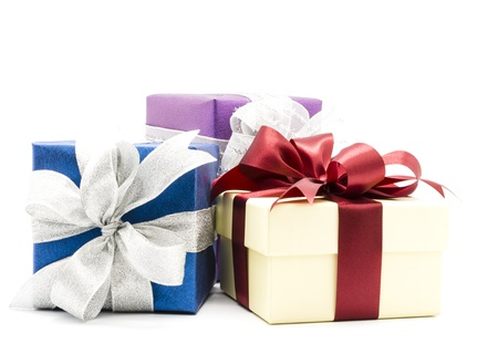 Three gift boxes decorated with ribbon isolated on white background.