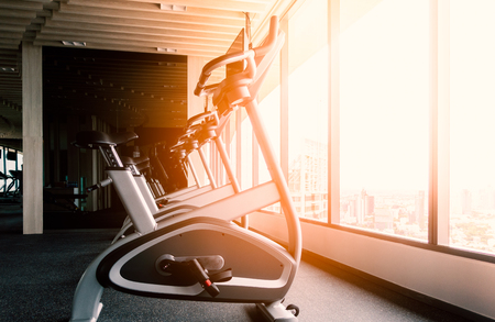 Photo pour Stationary bike for exercise in fitness room at the morning - image libre de droit