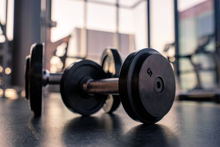Photo pour Dumbbell on the floor in luxury clubhouse wait for exercise in the morning - image libre de droit