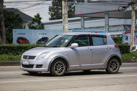 Chiangmai, Thailand - September 24 2018: Private Eco city Car Suzuki Swift. Photo at road no.121 about 8 km from downtown Chiangmai, thailand.