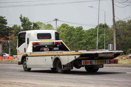 Photo for Chiangmai, Thailand - May 17 2019: Private Tow truck for emergency car move. Photo at road no 121 about 8 km from downtown Chiangmai, thailand. - Royalty Free Image