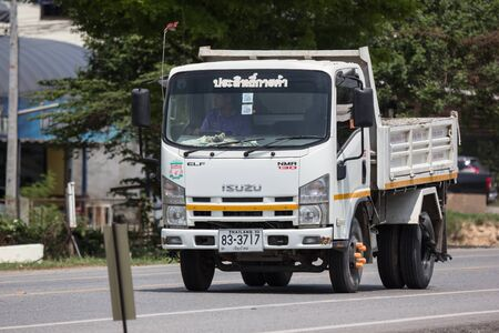Photo for Chiangmai, Thailand - May 28 2019: Private Isuzu Dump Truck. On road no.1001 8 km from Chiangmai Business Area. - Royalty Free Image