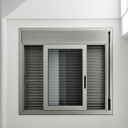 view of an aluminum sliding window with a roller shutter
