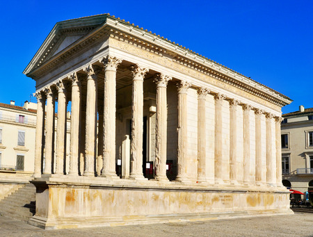 a lateral view of the ancient roman Maison Carree in Nimes, France