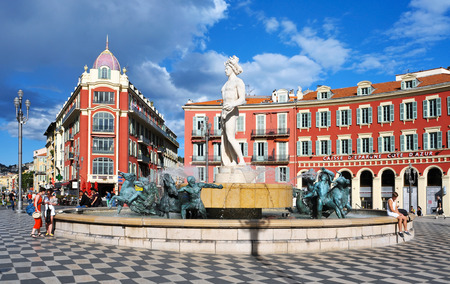 Nice, France - May 15, 2015: A view of the fountain Fontaine du Soleil at the Place Massena square in Nice, France. The Place Massena is the main public square in the town