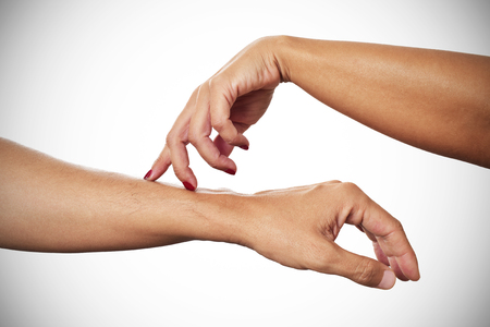 Photo pour a young woman caressing with her fingertips the arm of a young man - image libre de droit