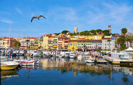 CANNES, FRANCE - JUNE 3, 2017: A view of the Vieux Port, the Old Port of Cannes, and Le Suquet district, the old town, in the background