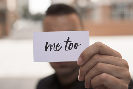 Photo pour closeup of a young caucasian man in the street showing a piece of paper with the text me too written in it - image libre de droit