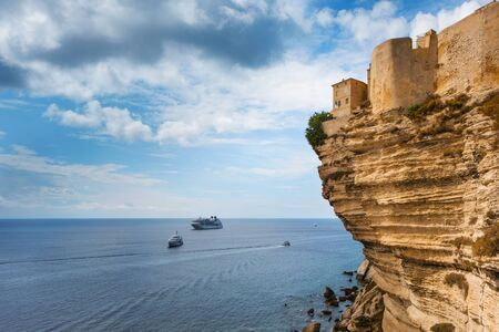 Photo pour a view of the picturesque Ville Haute, the old town of Bonifacio, in Corse, France, on the top of a cliff over the Mediterranean sea - image libre de droit