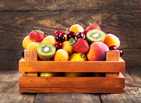 fresh fruits in wooden box